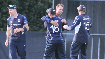 Con de Lange gets swarmed after dismissing Malcolm Waller for his maiden ODI five-for