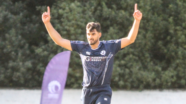 Safyaan Sharif holds his arms aloft after taking the final wicket