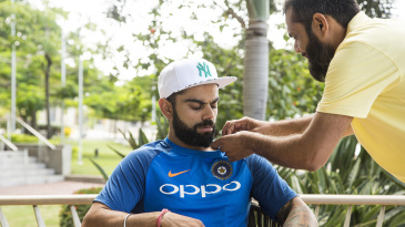 Virat Kohli has a mic attached to his shirt
