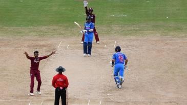 Devendra Bishoo had Shikhar Dhawan lbw for 87