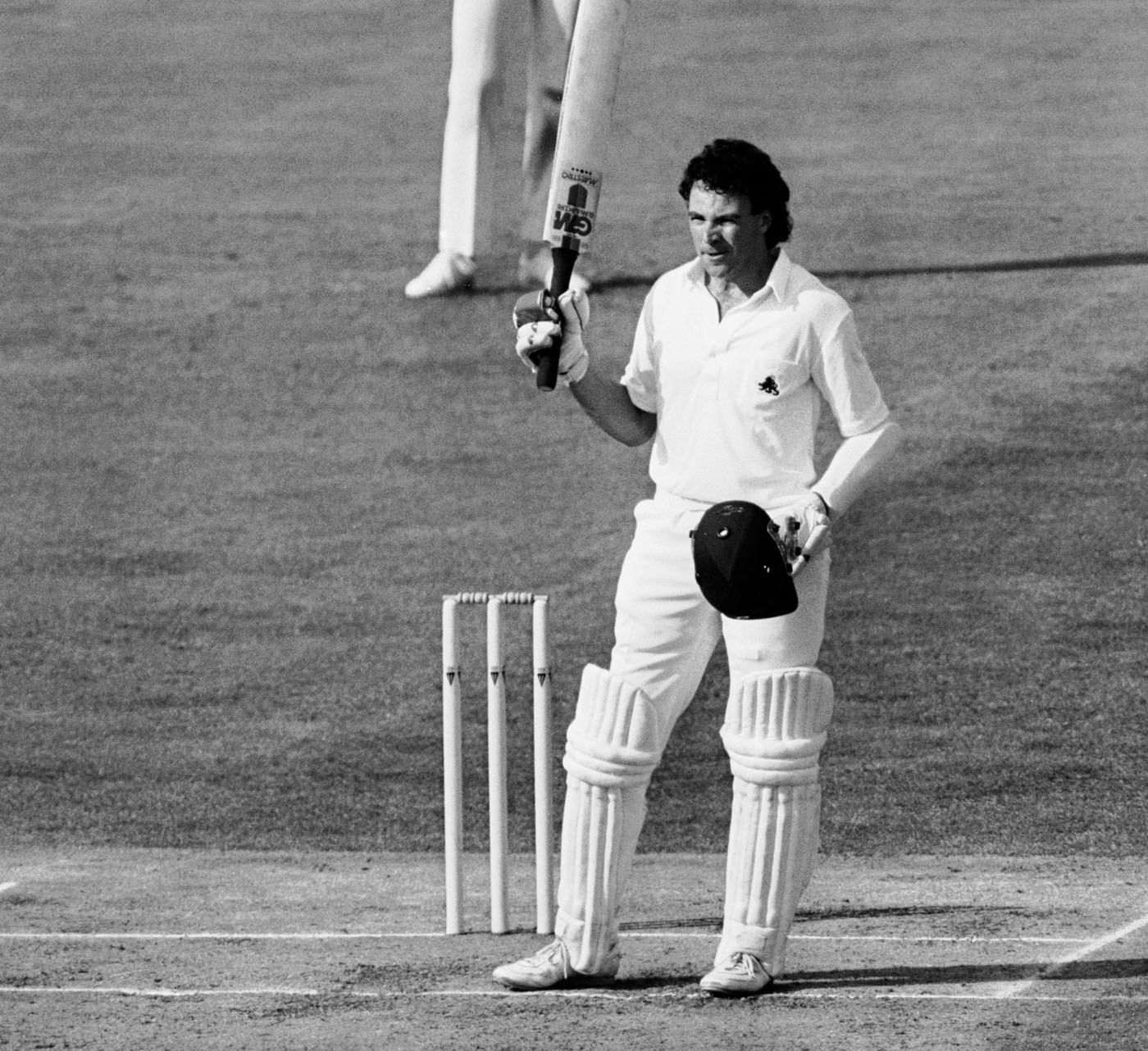 Robinson raises his bat after bringing up his century against Australia at Edgbaston in 1985: