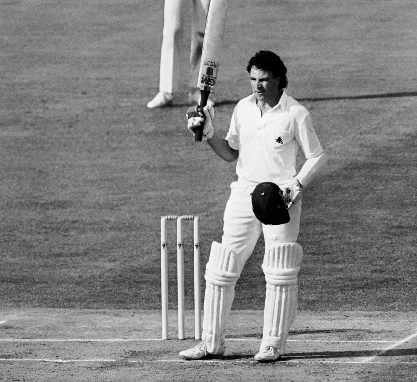 Robinson raises his bat after bringing up his century against Australia at Edgbaston in 1985: