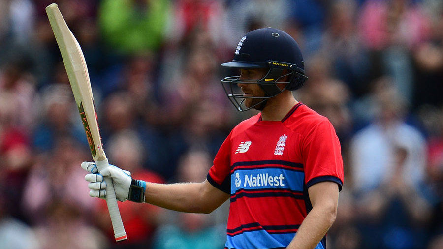 Dawid Malan raises his bat on reaching fifty