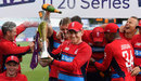 Eoin Morgan lifts the series trophy as the champagne corks pop in the background, England v South Africa, 3rd T20I, Cardiff, June 25, 2017