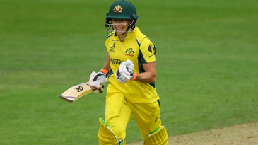 Nicole Bolton exults after getting to her century