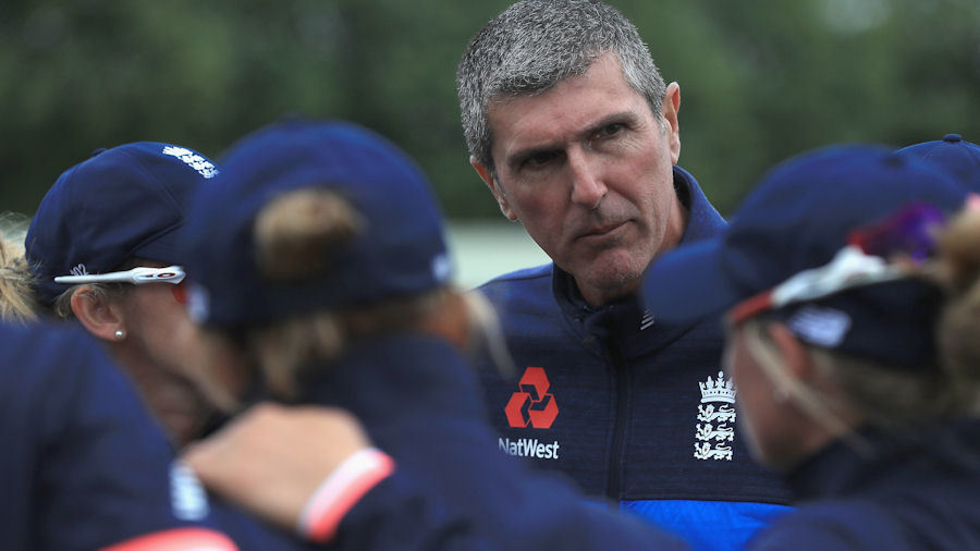 Mark Robinson, coach of England women, addresses the huddle