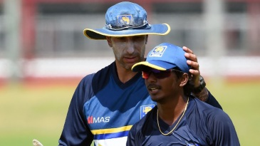 Nic Pothas, Sri Lanka's interim coach, with Lakshan Sandakan during a training session