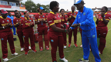 Sixteen-year-old debutant Qiana Joseph gets her cap from Ezra Moseley
