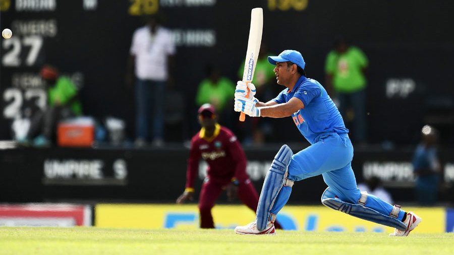 MS Dhoni pushes a ball into the off side