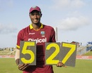 It's all mine: Jason Holder holds the scoring plates that shout out his best figures, West Indies v India, 4th ODI, Antigua, July 2, 2017