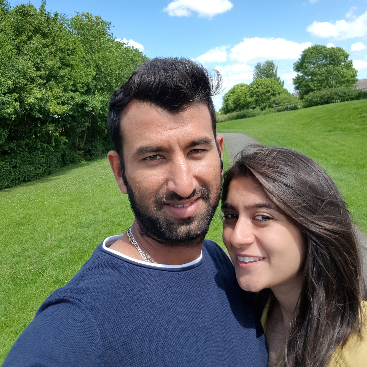 Pujara with his wife, Puja, in the UK
