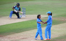 Poonam Yadav celebrates with Harmanpreet Kaur as Chamari Atapattu reflects on her dismissal in the background, India v Sri Lanka, Women's World Cup 2017, Derby, July 5, 2017