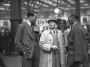 Ken Farnes (left) and Hedley Verity (right) are greeted by Farnes' father on their return to England at the end of the 1939 tour of South Africa, Waterloo Station, London, March 31,  1939
