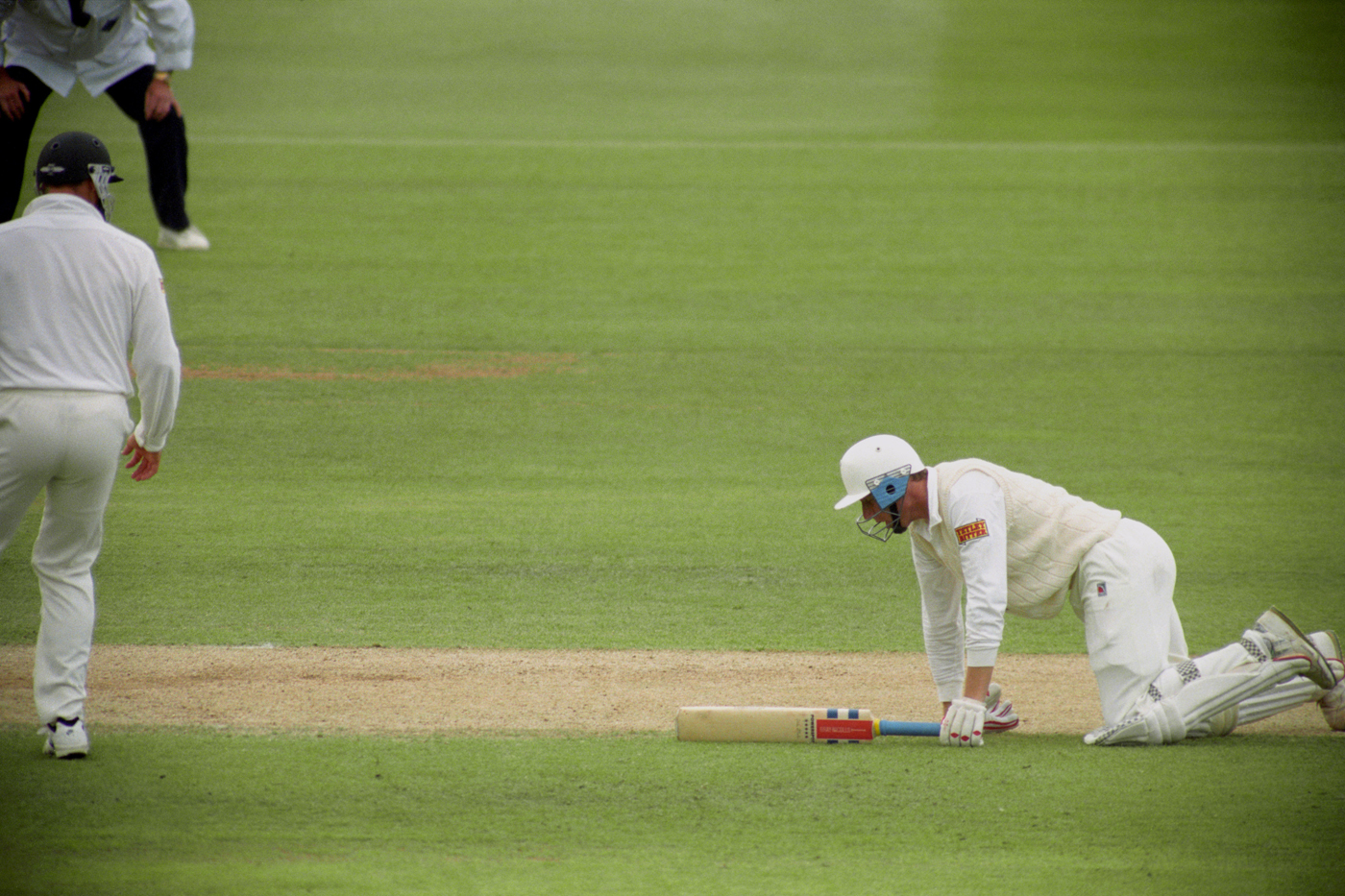 Mike Atherton is on his knees after being run out for 99