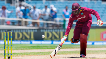 Chris Gayle scrambles to make the crease at the non-strikers end