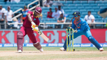 Evin Lewis takes on the spin and hits off the front foot