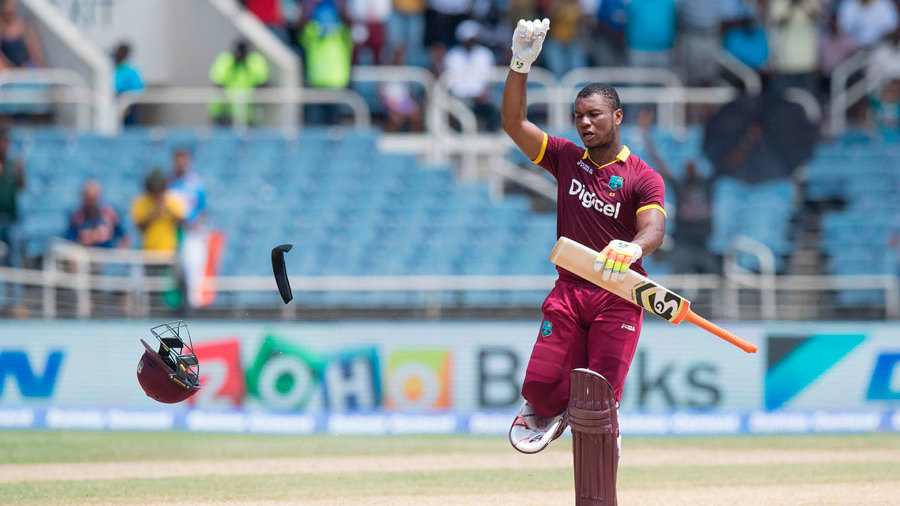 Evin Lewis chucks his helmet to the floor to celebrate his second T20I hundred