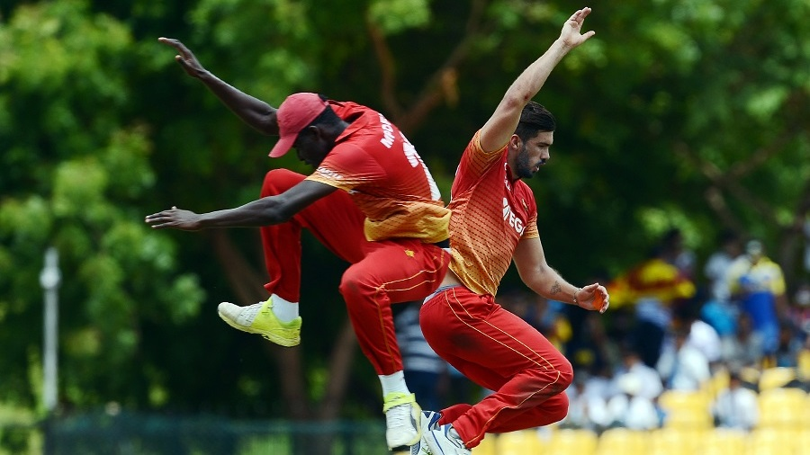 Graeme Cremer and Chris Mpofu take flight to celebrate a wicket