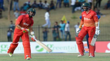 Sikandar Raza and Greaeme Cremer punch the air after knocking off the winning runs