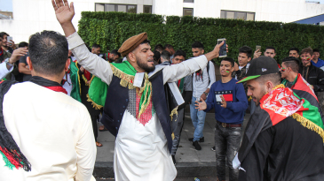 Afghanistan fans dance in the streets outside Lord's before the start of play