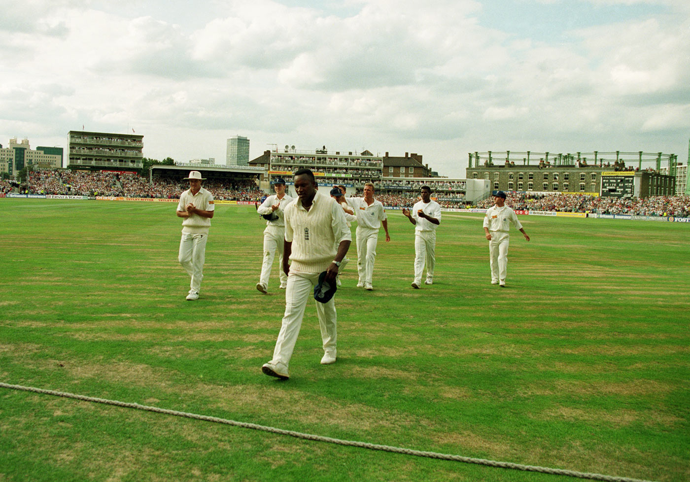 That's me done: Malcolm leads the team off the field on day three