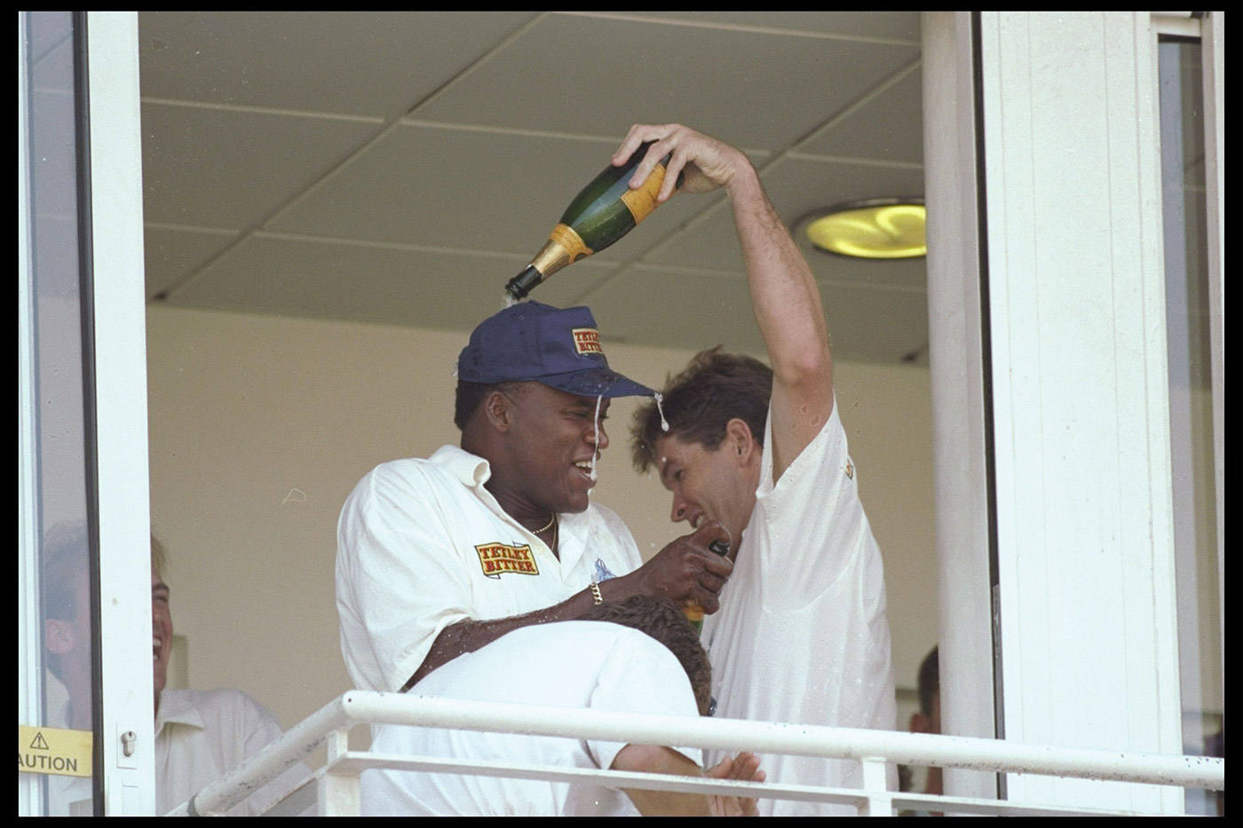 Hick gives Malcolm a champagne baptism in the dressing room