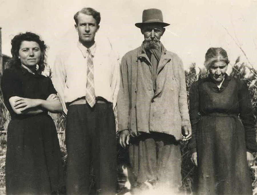 Mann with the Italian family that sheltered him during the war
