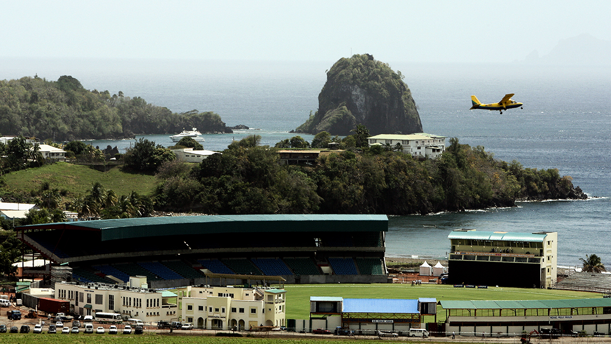 A plane flies over the Arnos Vale Ground in St Vincent