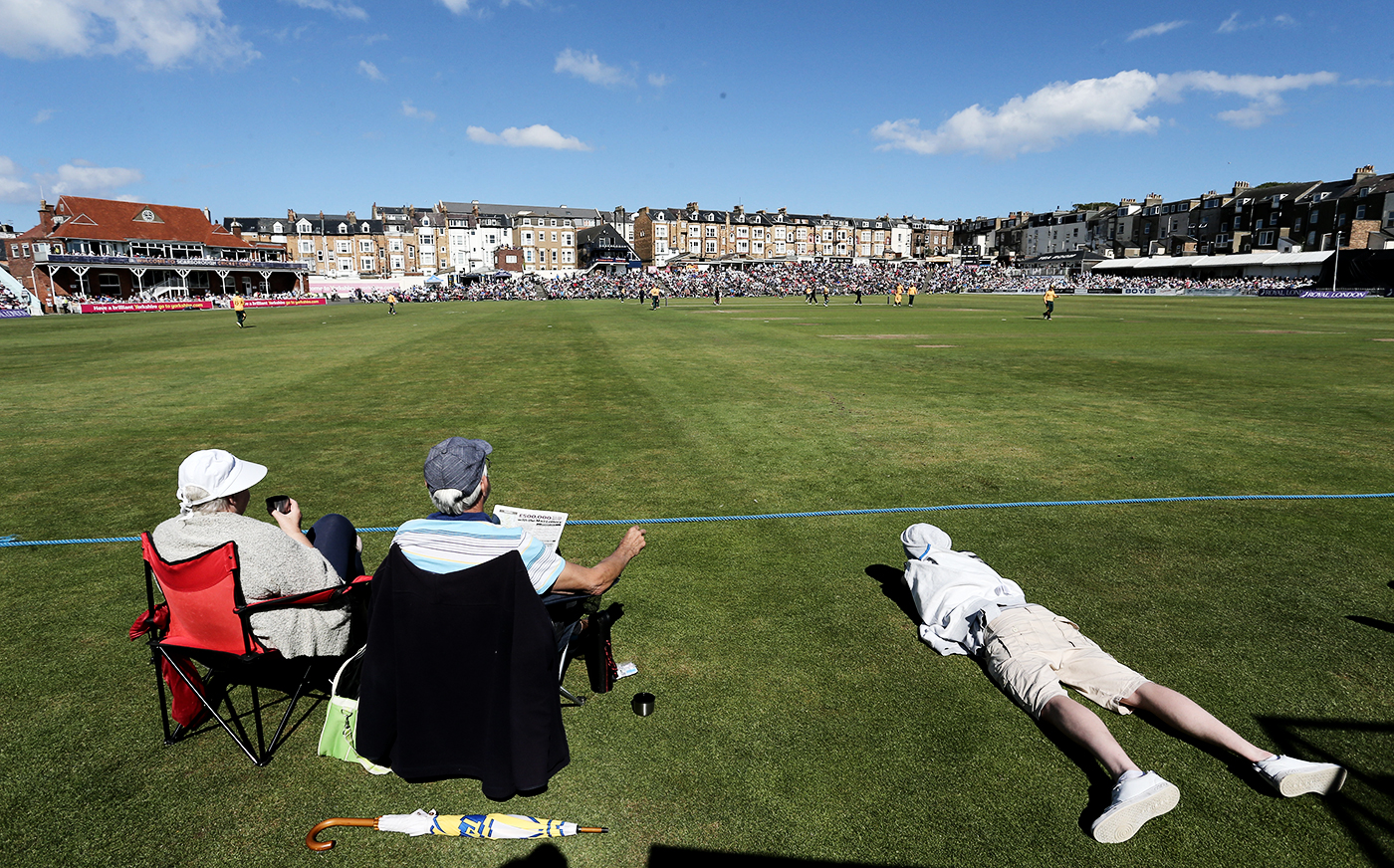 Spectators enjoy a summer afternoon on the boundary's edge in Scarborough, Yorkshire