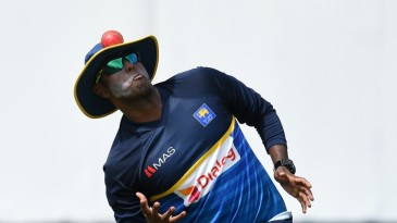 Eyes on the ball: Angelo Mathews balances a ball with his floppy hat