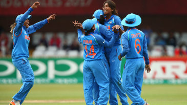 Jhulan Goswami celebrates with her team-mates after dismissing Rachel Priest