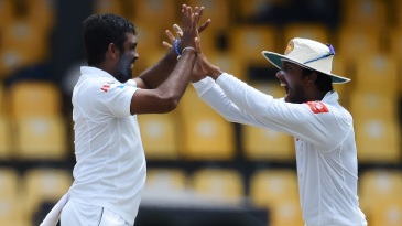 Dilruwan Perera celebrates a wicket with Dinesh Chandimal