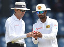 Dinesh Chandimal asks Nigel Llong to inspect the ball, Sri Lanka v Zimbabwe, only Test, 4th day, Colombo, July 17, 2017