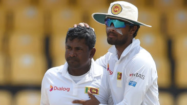 Dinesh Chandimal embraces a tired Ranagana Herath after the spinner picked up his 31st five-wicket haul