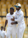 Dinesh Chandimal embraces a tired Ranagana Herath after the spinner picked up his 31st five-wicket haul, Sri Lanka v Zimbabwe, only Test, 4th day, Colombo, July 17, 2017
