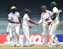 Graeme Cremer congratulates Rangana Herath on his 11-wicket haul, Sri Lanka v Zimbabwe, only Test, 4th day, Colombo, July 17, 2017
