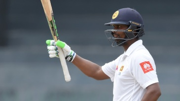 Asela Gunaratne acknowledges his fifty