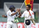 Dilruwan Perera and Asela Gunaratne celebrate after steering Sri Lanka to victory, Sri Lanka v Zimbabwe, only Test, 5th day, Colombo, July 18, 2017