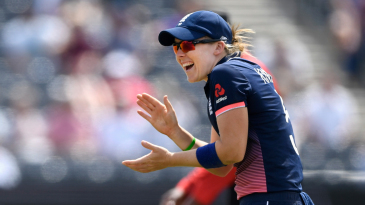 Heather Knight shares a joke with her team-mates
