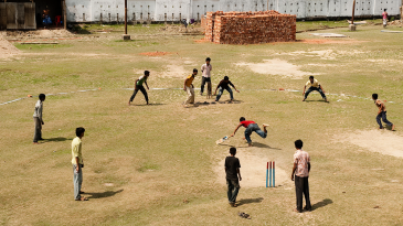 Kids play cricket outside the Shagoreka ground in Chittagong