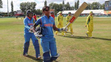 Harmanpreet Kaur acknowledges the cheers while walking off