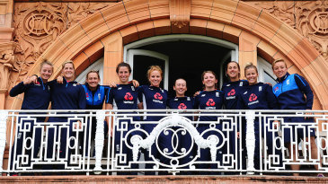 Members of the England team gather on the Lord's balcony