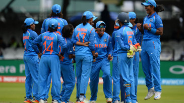 India celebrate their successful review against Heather Knight