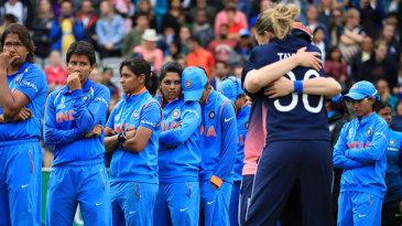 A tale of contrasts: The Indian team looks on as England celebrate the win