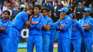 Indian players console each other after the loss