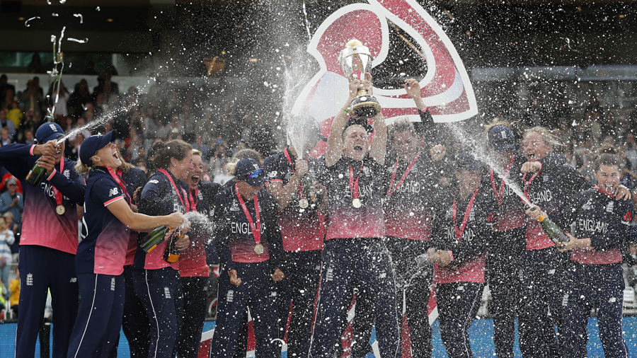 England captain Heather Knight lifts the World Cup amid showers of champagne