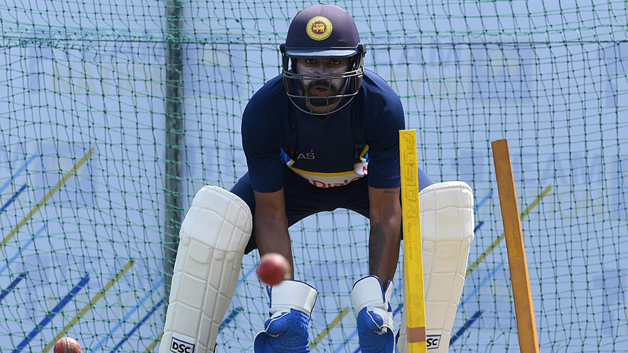 Niroshan Dickwella finetunes his wicketkeeping