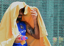 Virat Kohli tries to escape from the heat, Galle, July 25, 2017