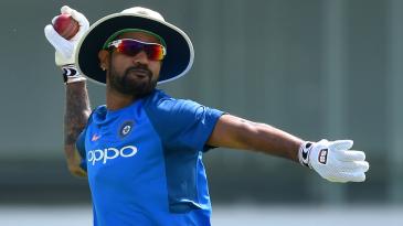Shikhar Dhawan goes through a fielding drill