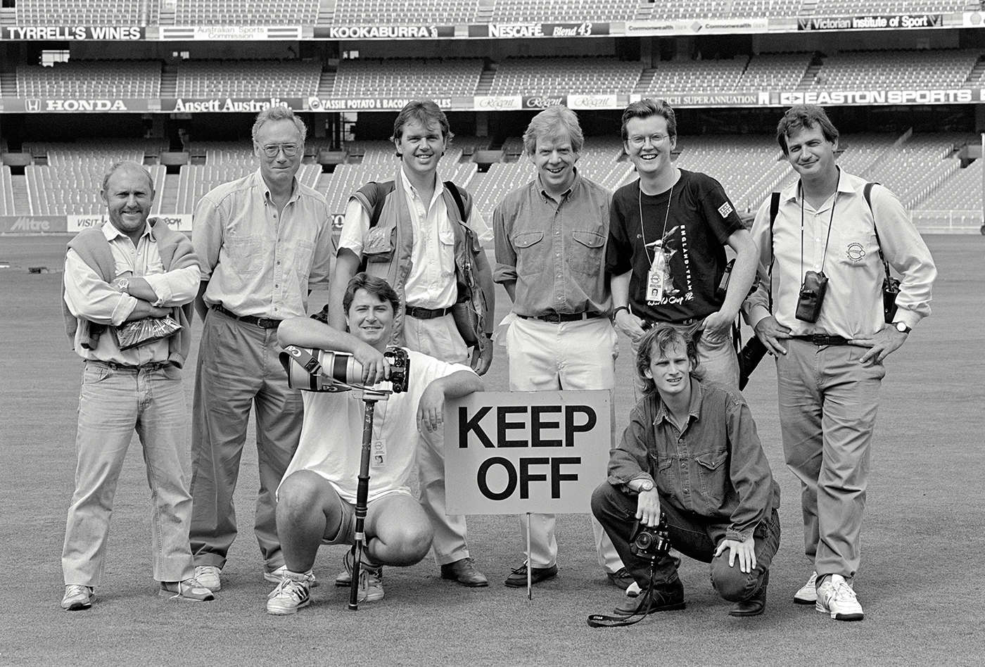 Cricket photographers (standing, from left) Joe Mann, Patrick Eagar, Graham Morris, Brendan Monks, Tom Jenkins, Adrian Murrell, (front row) Ben Radford and Graham Chadwick before the World Cup final at the MCG